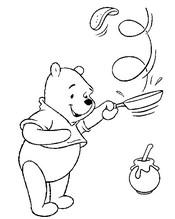 Coloriage Winnie l'ourson mange des crêpes au miel